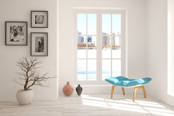 White room with chair and urban landscape in window. Scandinavian interior design