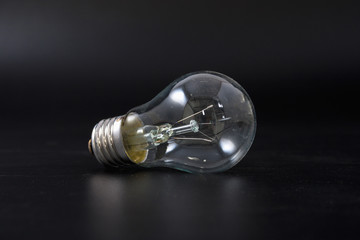 economical light bulb on a black background.