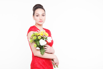 Beautiful well-groomed woman with a bouquet of flowers in their hands