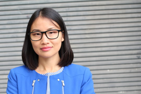 Asian businesswoman with glasses close up