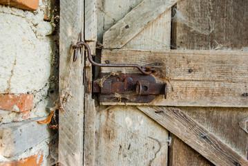 Old wood door with padlock
