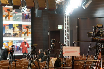 Berlin, Germany - February 13, 2017: photographers and cameramen equipments in empty conference hall. Selective focus