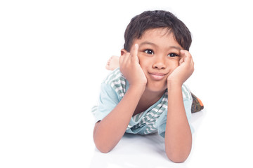 Asian boy sad lying on floor white background