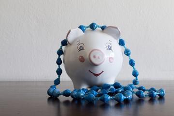 Wealthy piggybank with necklace symbolizing profit