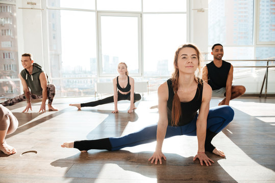 Group of people working out in yoga studio