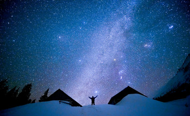 Human on the background of the starry sky