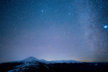 Milky Way above the snowy peaks of the Carpathian Mountains