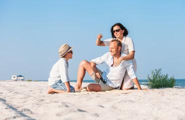 Family spent vacation time on desert sand sea beach
