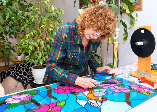 Artist works on the stained glass windows