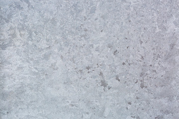 Abstract Texture background of frost rime ice pattern on glass window during winter in Europe