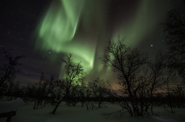 Northern lights in lapland landscape in Finland