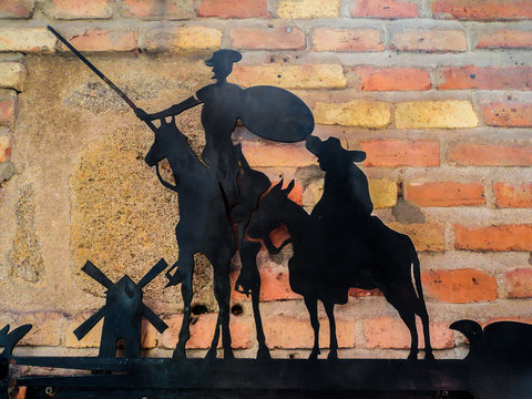 The plate with Don Quixote and Sancho Panza on the wall. Toledo, Spain