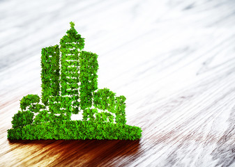 Green ecology city development icon on wooden background.