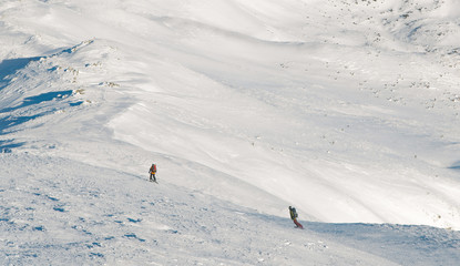 skier and snowboarder freeride in mountains