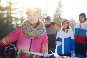 Healthy lifestyle image of happy snowboarders.