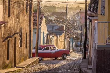 Cuban street with oldtimer in Trinidad, Cuba