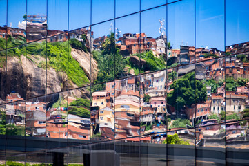 Reflection of Brazilian Slum in Windows of New Modern Business Building in Rio de Janeiro