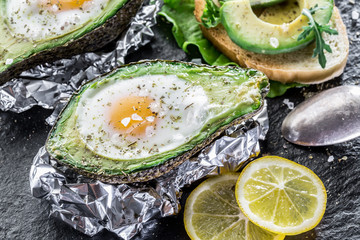 Chicken egg baked in avocado.