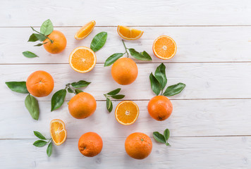 Ripe oranges on the white wooden table.
