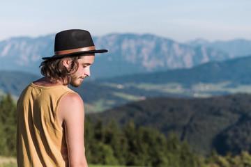 Austria, Mondsee, Mondseeberg, young man wearing a hat