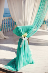 Wedding arch on the beach. Island. The ocean. Ceremony. Table. Registration. The champagne glasses.