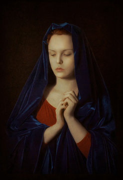 Madonna. Portrait of  praying girl. Imitation of  ancient picture. Toning, texture