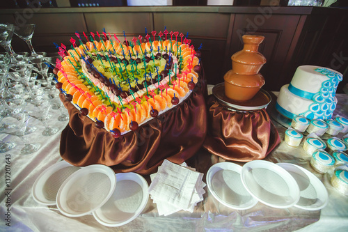 Chocolate Fountain And Heart From Fruits At Wedding Reception Stock
