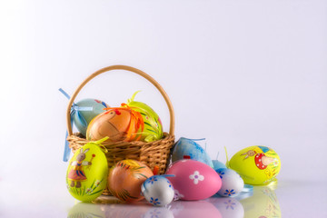 Easter eggs in the basket, isolated on white background.
