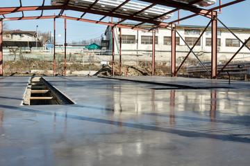 Fresh polished concrete slab and metal construction