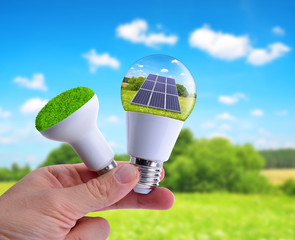 Hand holding eco LED bulbs. The concept of sustainable resources.