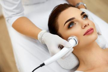 Fototapeta Body Care. Woman Receiving Face Skin Analysis. Cosmetology obraz