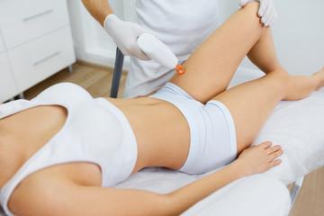 Beautician Using Professional Apparatus For Skin Procedure