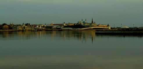 Kazan Kremlin and center in autumn day, reflected in river Kazanka, Russia