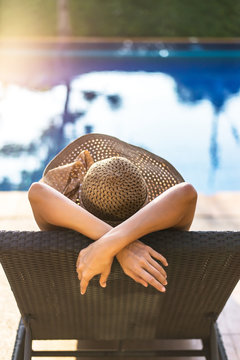 Women relaxing near luxury swimming pool