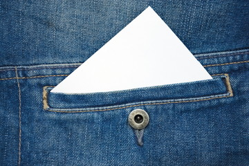 Close up of bussines card in the front pocket. Blank white card  with copy space in a pocket of jeans
