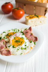 Fried eggs with bacon on white background