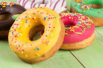 pile of glazed donuts isolated on white background