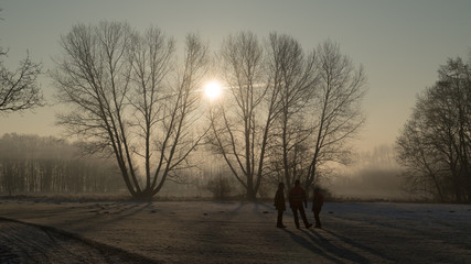 People in sunrise