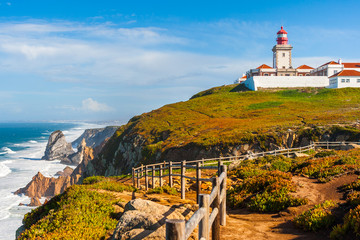 The lighthouse in Cabo da Roca. Cliffs and rocks on the Atlantic ocean coast in Sintra in a beautiful summer day, Portugal Fototapete