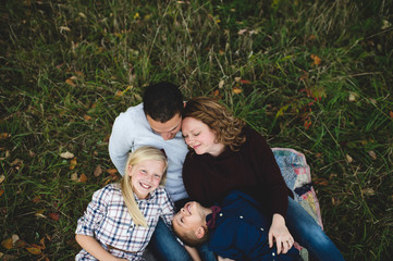 Overhead view of family lying down together on grass