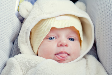 funny newborn baby in the car seat