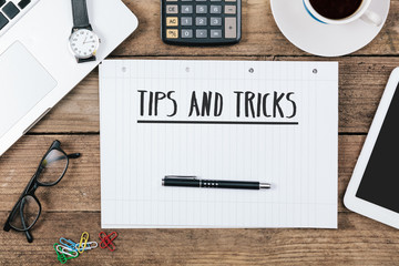 tips, tricks on notebook on Office desk with computer technology, high angle