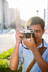 Man taking picture with a digital rangefinder camera, Kyoto, Japan