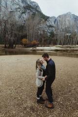 Romantic hiking couple by lake, Yosemite National Park, California, USA