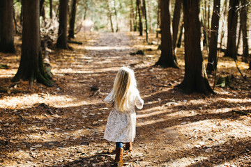 Blond haired girl in forest