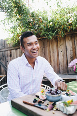 Man smiling at garden party