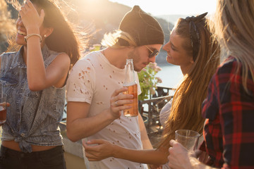 Adult friends dancing at waterfront roof terrace party, Budapest, Hungary