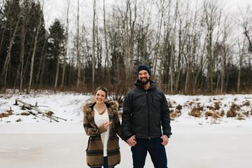 Happy couple on frozen lake, Whitby, Ontario, Canada