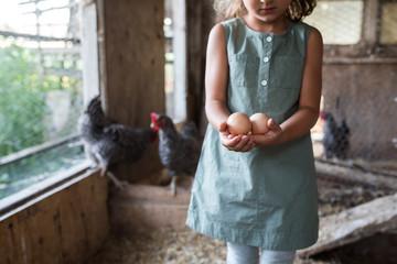 Girl holding fresh eggs