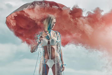 Conceptual portrait of a blonde holding smoky umbrella